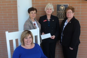 On the front porch of the new TN Fisher House - seated, Tammy Bivens of J & S Restaurants, Brenda Eckard, J & S Restaurants, Andrea Lawrence, and FH Board Member Felicia Hix
