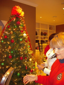Anne and Charlotte, members of TN Fisher House Board, decorating the tree.