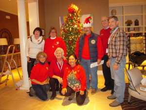TN Fisher House Board Members Proudly in front of the tree.