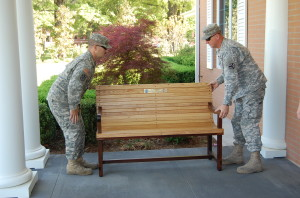 SPC Chris Evans and SGT Clint Reid carefully placing their work on the front porch