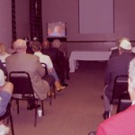 Attendees viewing the Fisher House DVD